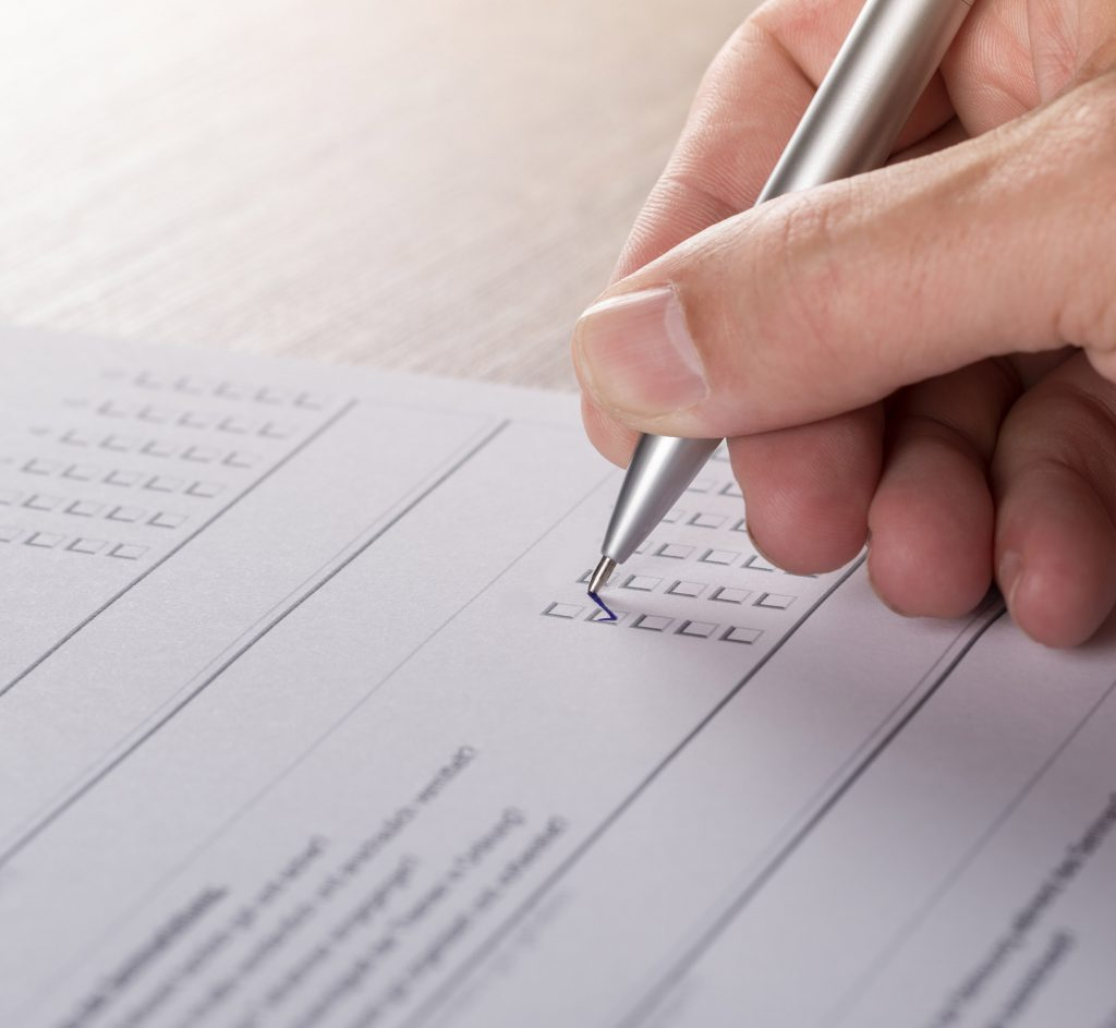 Picture of a person filling in an inspection report